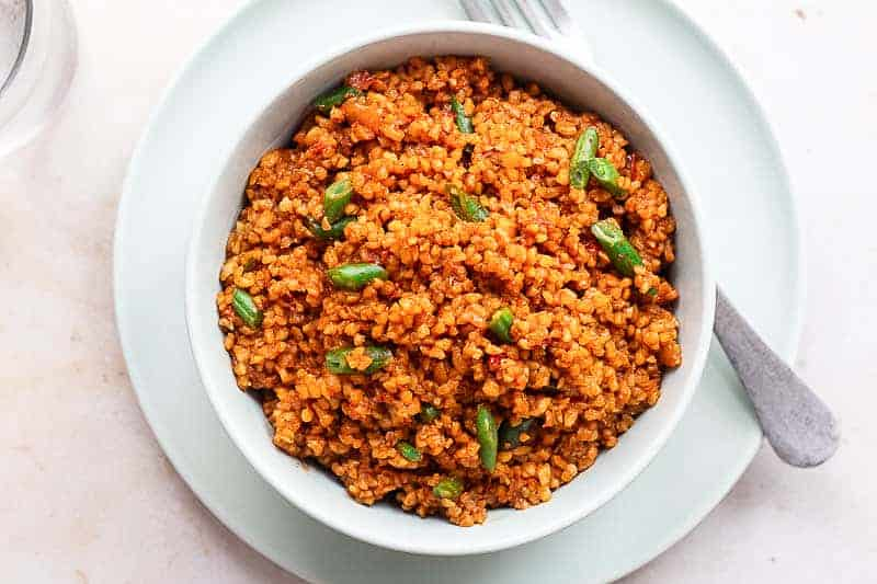 Jollof Bulgur. Bulgur wheat cooked in a spicy tomato and red pepper base sauce.