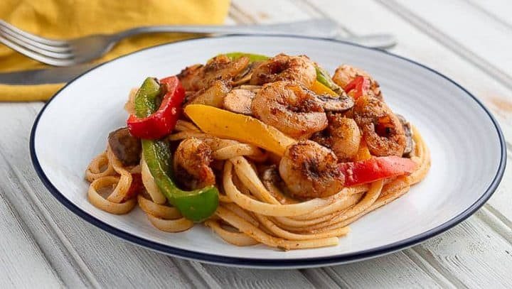 Pasta, shrimp and vegetables cooked with Cajun seasoning