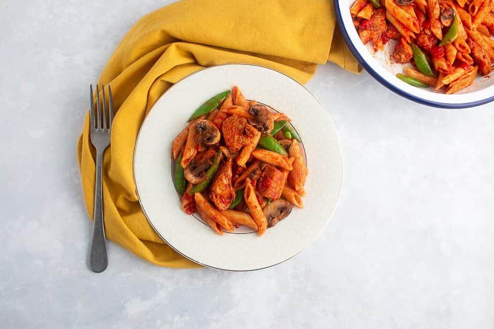 Beautiful image of pasta chicken dish cooked with berbere spices.