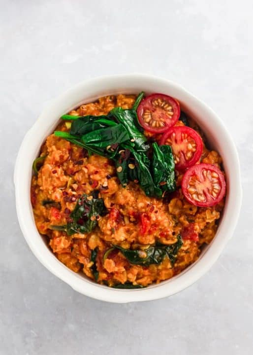 Savoury oats with jollof flavours in a bowl