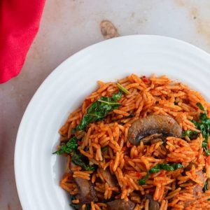 Vegetarian jollof rice, cooked with mushrooom and kale in a plate