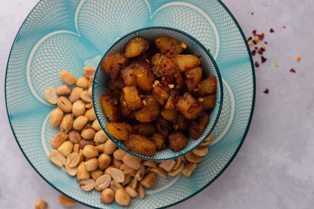 Kelewele   Spicy fried plantain in a bowl with some peanuts on the side