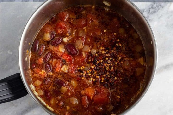 Matoke with beans cooking in a pot