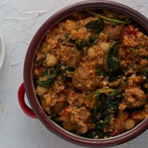 Ethiopian meatballs with berbere spices cooked in a tomato sauces with couscous, chickpeas and spinach