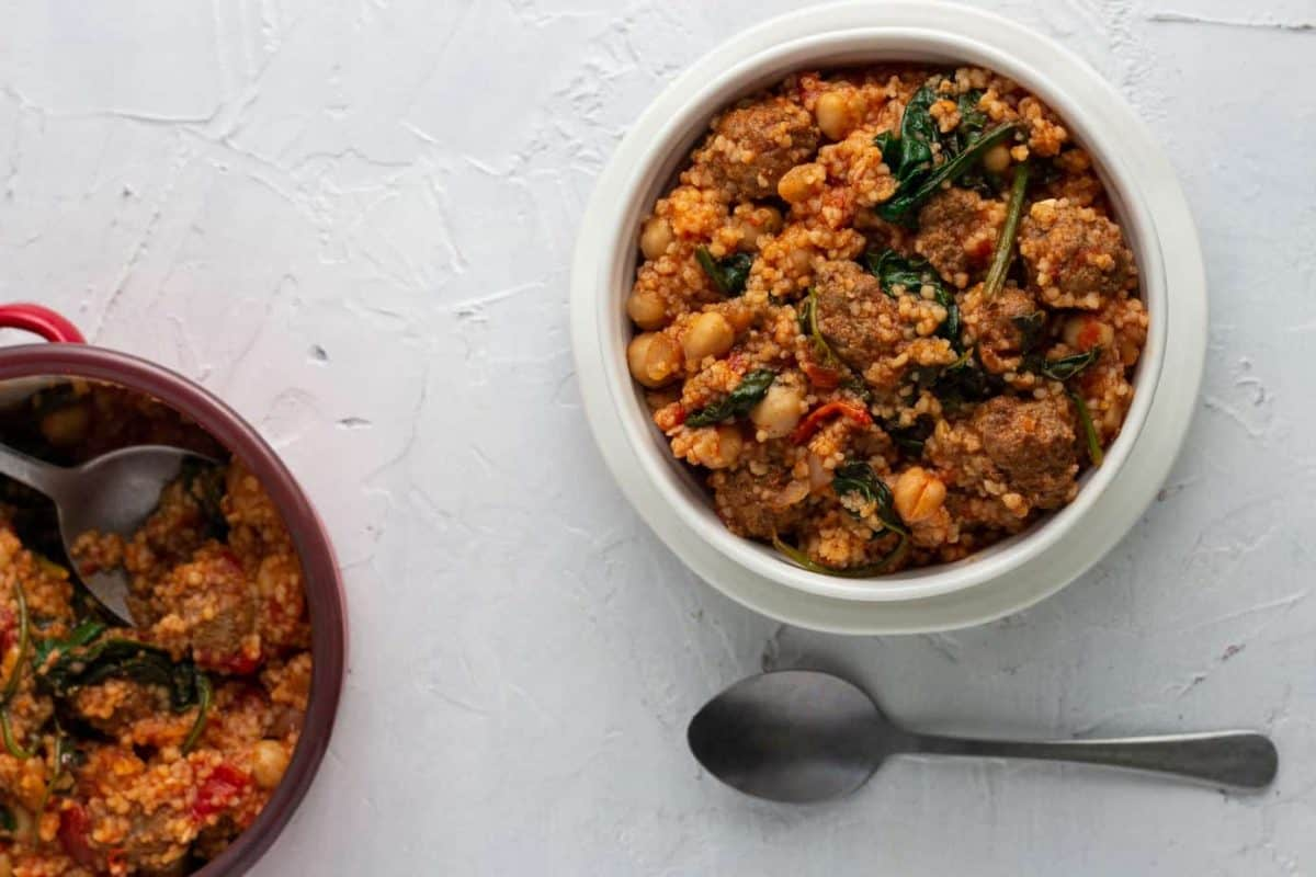 Ethiopian meatballs prepared with berbere spices, cooked in tomato sauces with couscous, chickpeas and spinach