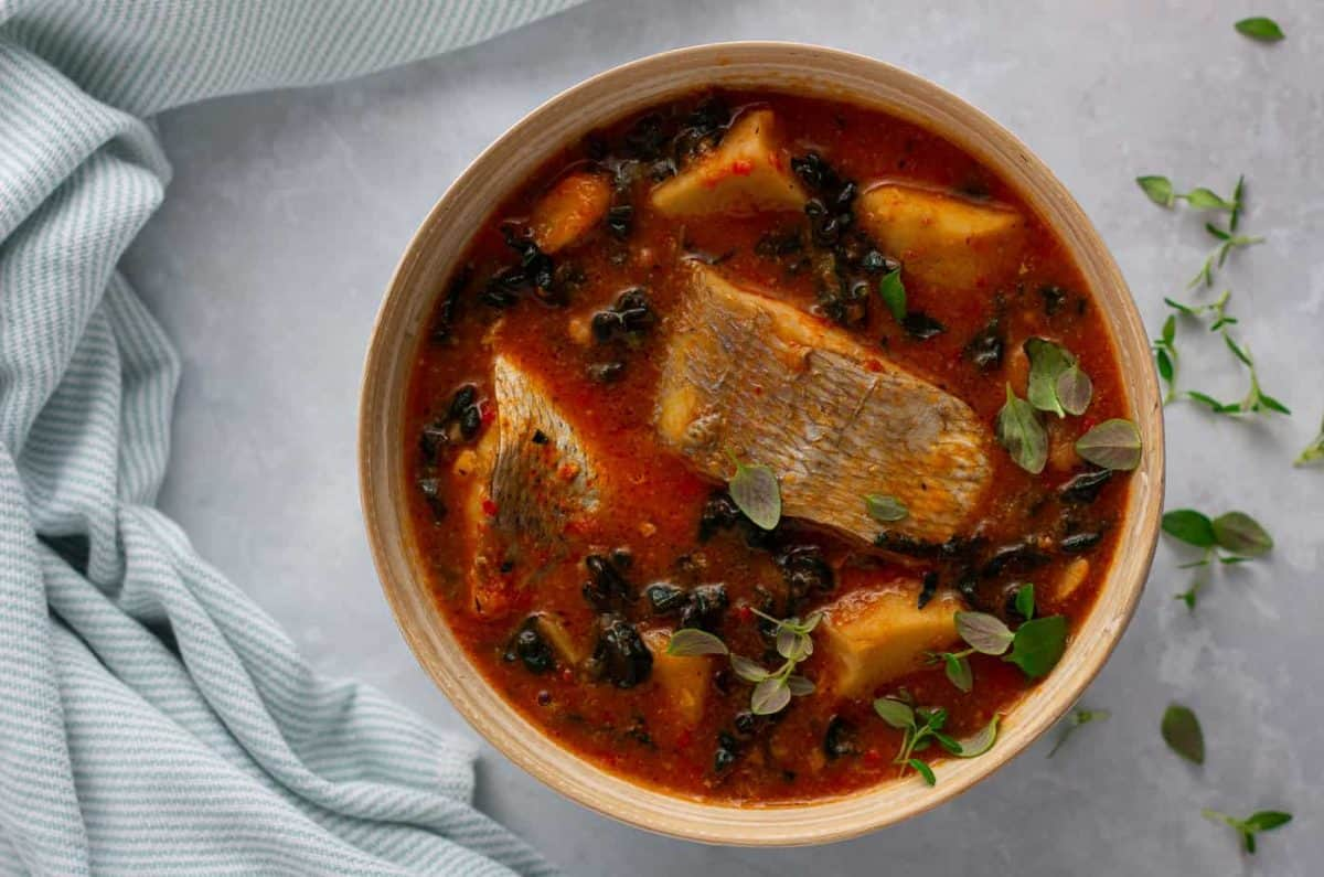 Cocoyam soup prepared with cocoyam, fish and kale in a bowl