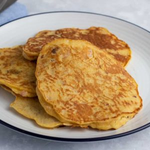 Plantain pancakes with prawns on a plate