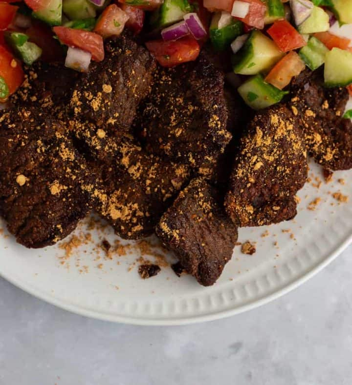 Air fryer suya in a plate with salad.