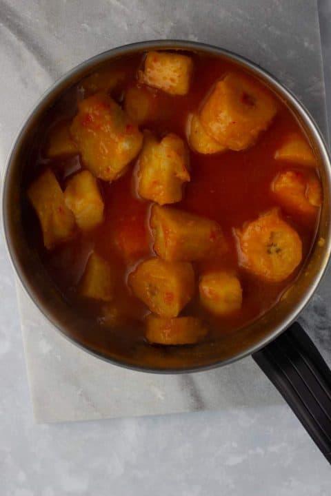 Yam porridge with plantain on a pot