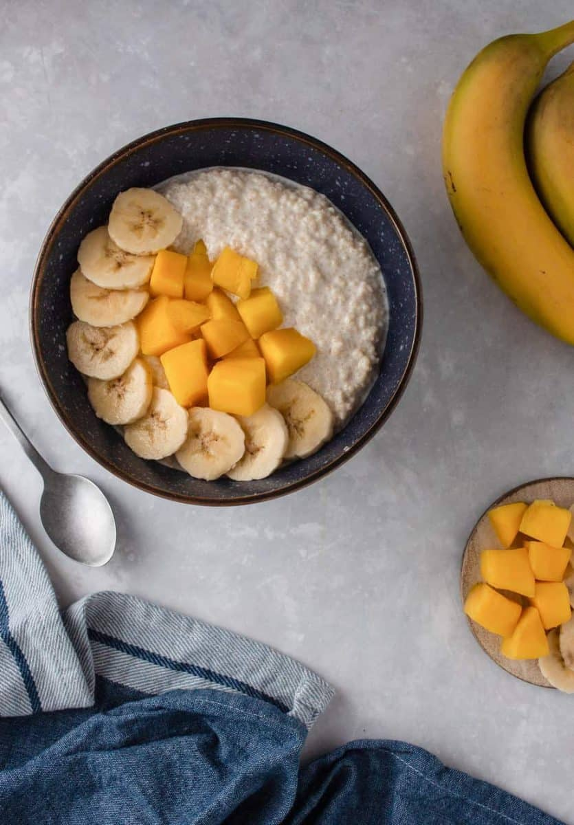 Breakfast Couscous Thiakry with mango and banana toppings