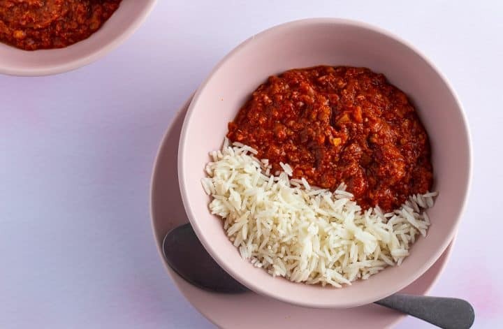 Nigeria corned beef stew served with rice in a bowl