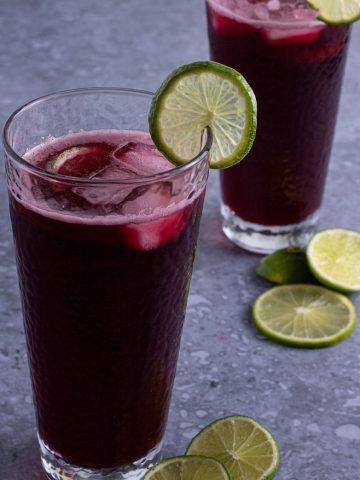 Sparkling zobo drink. Hibiscus drink with lemon garnish