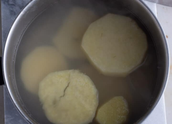 Cooked yam in a pot with the boiling water