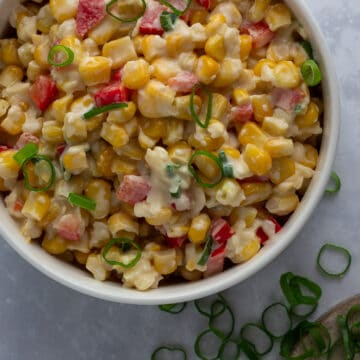 Creamy corn salad with spring onion garnish