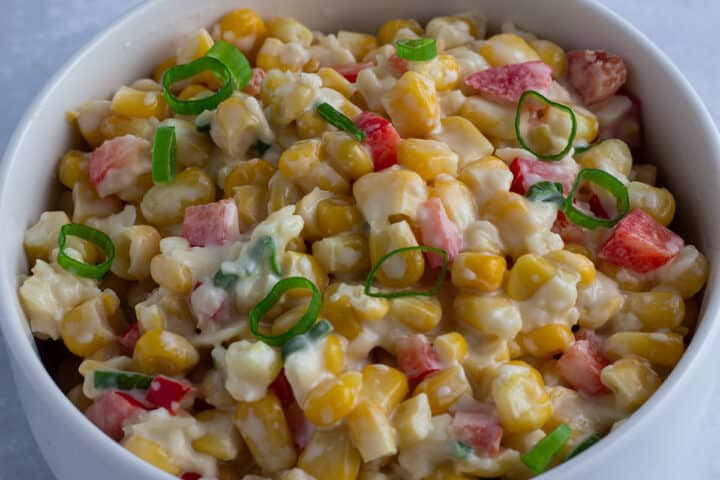 Creamy sweetcorn salad with peppers and spring onions